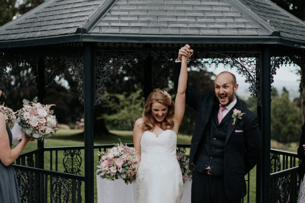 Outdoor Wedding Venues West Midlands_Bredenbury Court Barns_OUtdoor Ceremony Bride & Groom celebrate