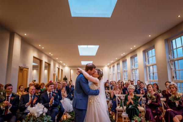 _0004_191227_Orangery_Wedding Ceremony Bride and Groom Kiss