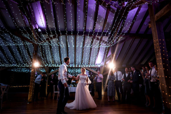 _0007_191227_Oak Barn_First Dance_Guests gathered round_Sparkly lights